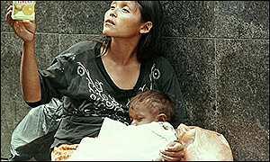 mujer-con-nino-en-venezuela.jpg